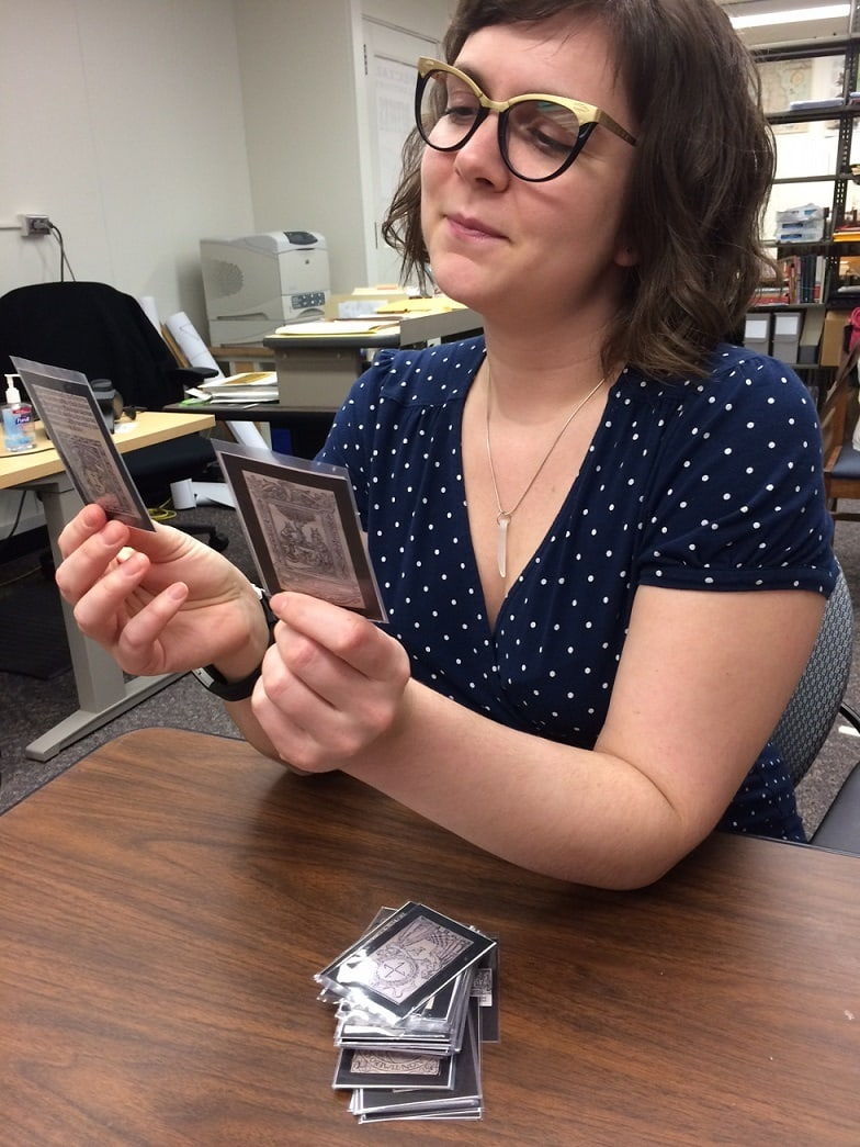 Laura hampton holding cards