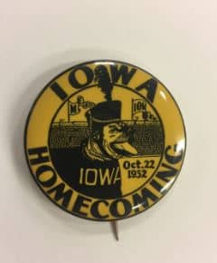Homecoming button with Rex the Dog on it