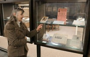 Jacque Roethler pointing out items in her exhibit