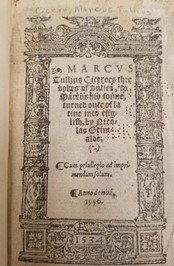 Ornate title page featuring arch around title text
